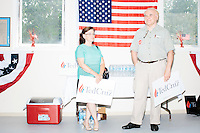 """Debbie Ladiue (left) of Newport News, VA, and her brother Paul Smith, of Hubbardston, MA, wait to hear Texas senator and Republican presidential candidate Ted Cruz speak to a crowd at the kick-off event at his New Hampshire campaign headquarters in Manchester, New Hampshire. Smith said he's a Trump supporter, but said that """"Cruz is more presidential than Trump."""" Ladieu said she is on the fence between Carson and Cruz."""