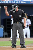 Home plate umpire Brian Fields makes a call during a game between the Charlotte Stone Crabs and St. Lucie Mets at Digital Domain Ballpark on June 20, 2011 in Port St Lucie, Florida.  St. Lucie defeated Charlotte 3-2 in 11 innings.  (Mike Janes/Four Seam Images)