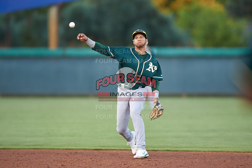 AZL Athletics Green shortstop Jhoan Paulino (8) throws to first base during an Arizona League game against the AZL Dodgers Lasorda at Camelback Ranch on June 19, 2019 in Glendale, Arizona. AZL Dodgers Lasorda defeated AZL Athletics Green 9-5. (Zachary Lucy/Four Seam Images)
