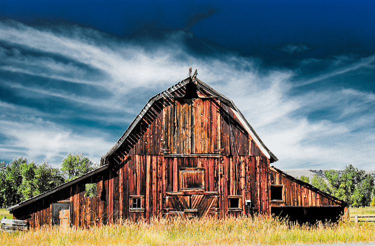 """""""HEAVENLY BARN""""<br /> <br /> Old barn on the Pintler Loop Scenic Drive in Montana. Barn stands with a halo of mares tail clouds."""
