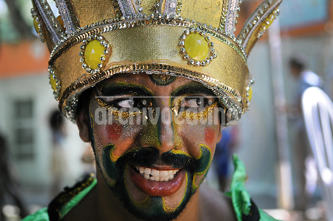 """A patient from mental health hospital Nise da Silveira participates at """"Loucura Suburbana,""""  (Suburban Madness) carnival group parade, Rio de Janeiro, Brazil, February 12, 2015. Patients, their relatives and workers from the institute held their parade one day before the official start of Carnival.."""