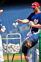 22 April 2010: Washington Nationals' first baseman Adam Dunn and teammates return balls to the basket after batting practice prior to a game against the Colorado Rockies at Nationals Park in Washington, DC. The Nationals were shut out by the Rockies 2-0 closing out their series with a 2-2 game split. Mandatory Credit: Ed Wolfstein Photo