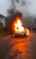 """Pictured: A Ford Ka car has been set alight in Waun-Wen Road in the Mayhill area of Swansea, Wales, UK. Thursday 20 May 2021<br /> Re: Gangs of """"yobs"""" have been setting fire to cars and rolling them down a hill in Swansea, Wales, UK.<br /> South Wales Police said they attended """"large scale disorder"""" in the Mayhill area of the city on Thursday evening."""