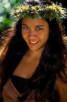 Young smiling Hawaiian hula dancer in a park in Honolulu on Oahu
