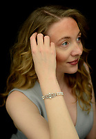 BNPS.co.uk (01202 558833)<br /> Pic: DixNoonanWebb/BNPS<br /> <br /> Pictured: Thomasina Smith of Dix Noonan Webb with the bracelet.<br /> <br /> A stunning bracelet Princess Margaret wore in her official 19th birthday photo was sold yesterday for £320,000 following an international bidding war - eight times its estimate.<br /> <br /> The Queen's younger sister sports the Art Deco cultured pearl and diamond bracelet in Royal photographer Cecil Beaton's 1949 portrait taken at Buckingham Palace.<br /> <br /> It is around her left arm as she is captured from the side in a white tulle embroidered dress against a landscape backdrop.<br /> <br /> The bracelet, which comes in a Cartier case and may have been made by the Paris jeweller, has a double row of cultured pearls bordering a line of circular-cut diamonds.<br /> <br /> It first emerged from the Countess of Snowdon collection 15 years ago and was today sold by a private collector with London-based auctioneers Dix Noonan Webb.