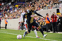 Carlos Valdes (5) of the Philadelphia Union shields the Dane Richards (19) of the New York Red Bulls from the ball. The New York Red Bulls defeated the Philadelphia Union  1-0 during a Major League Soccer (MLS) match at Red Bull Arena in Harrison, NJ, on October 20, 2011.