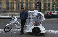 A Rickshaw sits in Westminster as snow sits in London as Beast from the East weather continues at City of London, London, England on 1 March 2018. Photo by Andy Rowland.