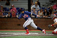 Danville Braves right fielder Henry Quintero (24) follows through on a swing during a game against the Johnson City Cardinals on July 28, 2018 at TVA Credit Union Ballpark in Johnson City, Tennessee.  Danville defeated Johnson City 7-4.  (Mike Janes/Four Seam Images)