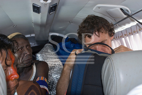 Pará State, Brazil. Patrick Cunningham with Caciques Kryt and Tumre Kayapó in the plane.