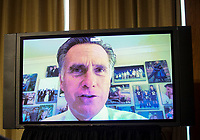 United States Senator Mitt Romney (Republican of Utah) is seen on a television monitor as he participates remotely during a US Senate Homeland Security and Governmental Affairs Committee oversight hearing examining the U.S. Customs and Border Protection (CBP) on Capitol Hill in Washington, U.S., June 25, 2020.<br /> Credit: Alexander Drago / Pool via CNP/AdMedia
