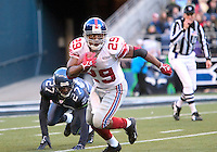 New York Giants kick returner #29 Chad Morton zips past Seattle Seahawks special team player #27 Jordan Babineaux during the third quarter at Quest Field in Seattle, WA.