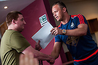 Friday  25 March 2016<br /> Pictured: Lee Trundle Hands out certificates <br /> Re: Pen y Bryn Special school  launch their Swansea City FC book at the Liberty Stadium, Swansea, Wales, UK