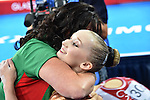 Wales' Georgina Hockenhull hugs a coach at the end of her performance in the women's gymnastics artistic balance beam final<br /> <br /> Photographer Chris Vaughan/Sportingwales<br /> <br /> 20th Commonwealth Games - Day 9 - Friday 1st August 2014 - Gymnastics - SECC - Glasgow - UK