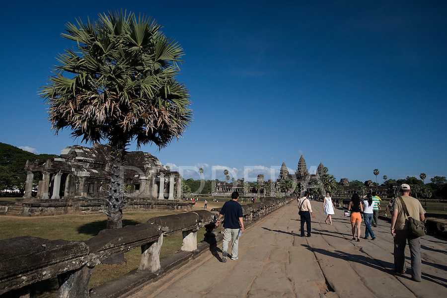 Tourists visit the ancient temple of Angkor Wat, in northwestern Cambodia, where Khmer kings established their capitals from the ninth to the twelfth century.