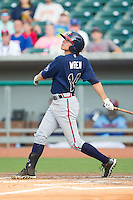 Kyle Wren (14) of the Mississippi Braves follows through on his swing against the Tennessee Smokies at Smokies Park on July 22, 2014 in Kodak, Tennessee.  The Smokies defeated the Braves 8-7 in 10 innings. (Brian Westerholt/Four Seam Images)