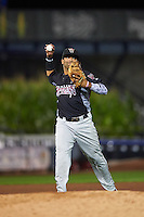 Wisconsin Timber Rattlers third baseman Sthervin Matos (9) throws to first during the second game of a doubleheader against the Quad Cities River Bandits on August 19, 2015 at Modern Woodmen Park in Davenport, Iowa.  Quad Cities defeated Wisconsin 8-1.  (Mike Janes/Four Seam Images)