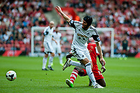 Sun 06 October 2013 Pictured: Michu of Swansea gets the better of Victor Wanyama Re: Barclays Premier League Southampton FC  v Swansea City FC  at St.Mary's Stadium, Southampton
