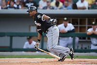 Micah Johnson (7) of the Chicago White Sox follows through on his swing against the Charlotte Knights at BB&T Ballpark on April 3, 2015 in Charlotte, North Carolina.  The Knights defeated the White Sox 10-2.  (Brian Westerholt/Four Seam Images)