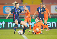 BREDA, NETHERLANDS - NOVEMBER 27: Samantha Mewis #3, Julie Ertz #8 of the United States chase down a loose ball with  Katja Snoeijs #17 of the Netherlands during a game between Netherlands and USWNT at Rat Verlegh Stadion on November 27, 2020 in Breda, Netherlands.