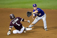 LSU Tigers shortstop Alex Bregman (30) turns a double play against the Texas A&M Aggies in the NCAA Southeastern Conference baseball game on May 10, 2013 at Blue Bell Park in College Station, Texas. LSU defeated Texas A&M 7-4. (Andrew Woolley/Four Seam Images).