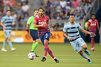 KANSAS CITY, KS - JULY 31: Facundo Quignon #5 FC Dallas with the ball during a game between FC Dallas and Sporting Kansas City at Children's Mercy Stadium on July 31, 2021 in Kansas City, Kansas.
