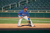 AZL Rangers first baseman Yaniery Guzman (19) during an Arizona League game against the AZL Athletics Gold on July 15, 2019 at Hohokam Stadium in Mesa, Arizona. The AZL Athletics Gold defeated the AZL Rangers 9-8 in 11 innings. (Zachary Lucy/Four Seam Images)