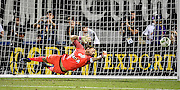Orlando, FL - Saturday Jan. 21, 2017: São Paulo defender Junior (16) watches the penalty shot go just beyond his reach and into the goal during the penalty kick shootout of the Florida Cup Championship match between São Paulo and Corinthians at Bright House Networks Stadium. The game ended 0-0 in regulation with São Paulo defeating Corinthians 4-3 on penalty kicks.