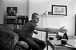Skinhead Jimmy John ( 19yrs ) 1980 at home in Tower Hamlets east London Uk. He had a French girl friend and is drinking Mateus rose wine very popular at the time. The drawing on the mantle is by him. He worked as a hospital refuse porter at Royal London Hospital Whitechapel. Ex punk, ex rocker.