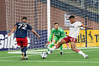 FOXBOROUGH, MA - JUNE 26: Alisson #27 of North Texas SC moves to intercept a pass near the goal by Damian Rivera #72 of the New England Revolution during a game between North Texas SC and New England Revolution II at Gillette Stadium on June 26, 2021 in Foxborough, Massachusetts.
