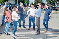 South Bend mayor and Democratic presidential candidate Pete Buttigieg and campaign staff leave the Iowa State Fair in Des Moines, Iowa, on Tues., Aug. 13, 2019.