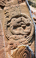 Norman Romanesque relief sculptures of dragons from the South doorway of Church of St Mary and St David, Kilpeck Herifordshire, England. Built around 1140