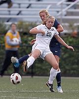 Yale University defender Christina Bradley (9) and Harvard University midfielder Lauren Urke (20) battle for the ball. In overtime, Harvard University defeated Yale University,1-0, at Soldiers Field Soccer Stadium, on September 29, 2012.