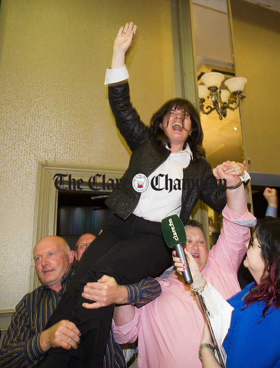 Fianna Fail's Clare Colleran Molloy is lifted up by supporters as the result of a recount favouring her is made clear during the election count at The West county Hotel, Ennis. Photograph by John Kelly.