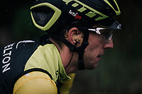 (hidden under a rain-jacket) yellow jersey / GC leader Simon Yates (GBR/Michelton-Scott) trying to defend his standing in the rain<br /> <br /> 76th Paris-Nice 2018<br /> Stage 8: Nice > Nice (110km)