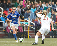Duke University forward Kelly Cobb (9) on the attack. Boston College (white) defeated Duke University (blue/white), 4-1, at Newton Campus Field, on October 6, 2013.