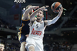 Real Madrid's Rudy Fernandez (r) and Alba Berlin's Niels Giffey during Euroleague match.March 12,2015. (ALTERPHOTOS/Acero)