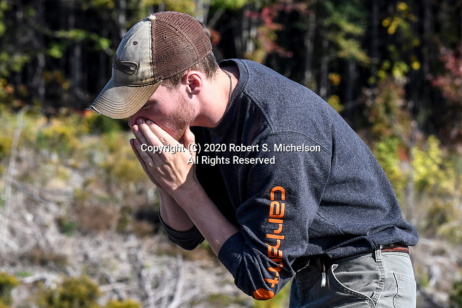 Maine Department of Inland Fisheries and Wildlife Wildlife Technician, Carter Barthelman, calls for moose. During the moose breeding season-the rut.   Moose hunters try to imitate the call of a cow in estrus.  This call is a long, plaintive moaning.   This is telling a bull that she is receptive and ready to breed.  If a bull responds to the cow, the bull will make a deep, guttural grunt expelling air.   He will make the call repeatingly as he moves towards the cow call and tries to scent the female.