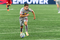 FOXBOROUGH, MA - AUGUST 29: Benjamin Mines #17 of New York Red Bulls brings the ball forward during a game between New York Red Bulls and New England Revolution at Gillette Stadium on August 29, 2020 in Foxborough, Massachusetts.