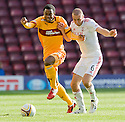 MOTHERWELL'S OMAR DALEY AN ABERDEEN'S ANDREW CONSIDINE CHALLENGE FOR THE BALL