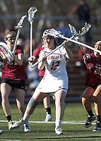 Boston College attacker Moira Barry (12) takes a shot.