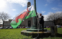 Lord Mayor for Swansea David Hopkins raises a Wales flag in the shape of a red lobster instead of a red dragon outside the Guildhall, to raise awareness for Skin Care Cymru, in Swansea, Wales, UK. Tuesday 28 February 2017