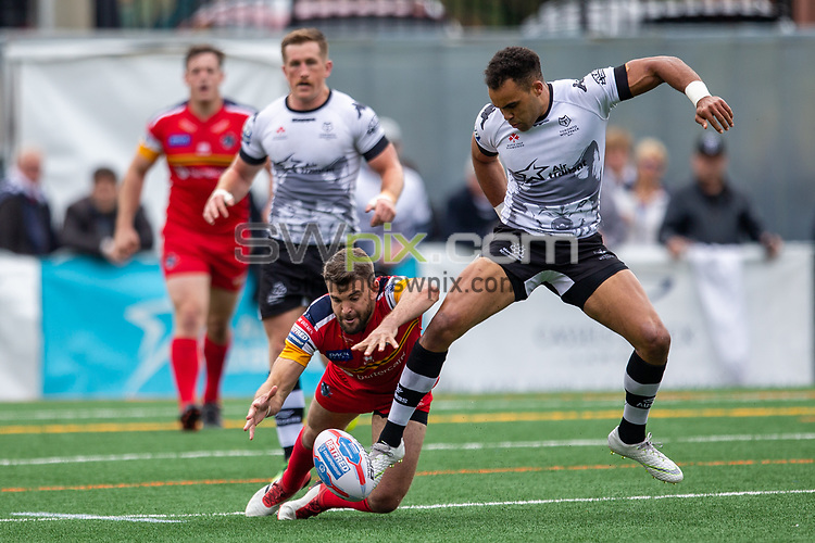 Picture by Kevin Sousa/SWpix.com - 07/10/2018 - Rugby League - Betfred Super League - The Qualifiers - Million Pound Game - Toronto Wolfpack v London Broncos - Lamport Stadium, Toronto, Canada - Mason Caton-Brown #34 attempts to kick the ball during the first half.