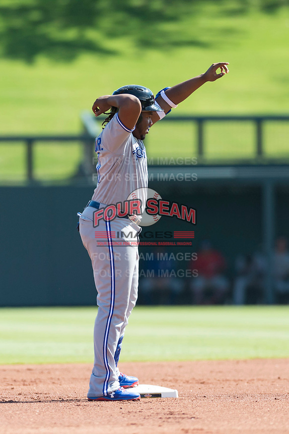 Surprise Saguaros third baseman Vladimir Guerrero Jr. (27), of the Toronto Blue Jays organization, celebrates after hitting a double during an Arizona Fall League game against the Salt River Rafters at Salt River Fields at Talking Stick on October 23, 2018 in Scottsdale, Arizona. Salt River defeated Surprise 7-5 . (Zachary Lucy/Four Seam Images)