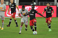 WASHINGTON, DC - SEPTEMBER 12: Mohammed Abu #25 of D.C. United battles for the ball with Cristian Casseres Jr. #23 of New York Red Bulls during a game between New York Red Bulls and D.C. United at Audi Field on September 12, 2020 in Washington, DC.