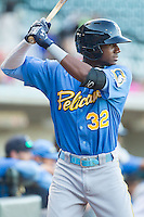 Lewis Brinson (32) of the Myrtle Beach Pelicans at bat against the Winston-Salem Dash at BB&T Ballpark on July 16, 2014 in Winston-Salem, North Carolina.  The Pelicans defeated the Dash 6-2.   (Brian Westerholt/Four Seam Images)