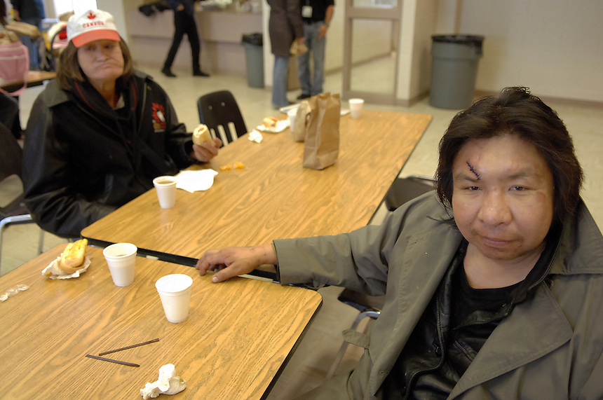 Ernie Anderson, left, and John Kenny warm up with hot dogs and hot chocolate at a North Central community Christmas party. Kenny passed away in March of 2008. MARK TAYLOR GALLERY