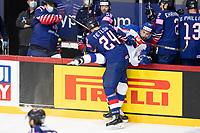 23rd May 2021, Riga Olympic Sports Centre Latvia; 2021 IIHF Ice hockey, Eishockey World Championship, Great Britain versus Slovakia;  24 Joshua Tetlow Great Britain charges into Juraj Slafkovsky Slovakia and puts him over the boards