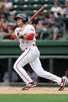 Second baseman Hector Lorenzana (20) of the Greenville Drive bats in a game against the Asheville Tourists on Sunday, July 20, 2014, at Fluor Field at the West End in Greenville, South Carolina. Lorenzana was a 2014 draft pick of the Boston Red Sox out of the University of Oklahoma. Asheville won game two of a doubleheader, 3-2. (Tom Priddy/Four Seam Images)