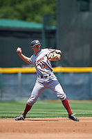 Altoona Curve shortstop Kevin Newman (19) warmup throw to first during a game against the Erie SeaWolves on July 10, 2016 at Jerry Uht Park in Erie, Pennsylvania.  Altoona defeated Erie 7-3.  (Mike Janes/Four Seam Images)