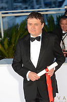 Romanian director Cristian Mungiu winner of the Best Director prize for the film 'Graduation (Bacalaureat)' at the Palme D'Or Winner Photocall during the 69th annual Cannes Film Festival at the Palais des Festivals on May 22, 2016 in Cannes, France.